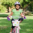 Little girl with her bike — Stock Photo