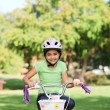 Little girl with her bike — Stock Photo #10857082