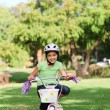 Little girl with her bike - Stock Photo