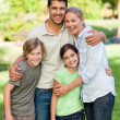 Happy family in park — Stockfoto #10857099