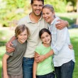Foto Stock: Happy family in park