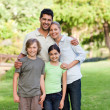 Happy family in the park — Stock Photo #10857102