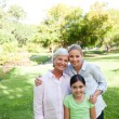 Cute family in the park — Stock Photo #10857162