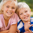 Boy with his sister in the park — Stock Photo #10857288
