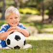 Boy with his ball in the park — Stock Photo