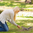Beautiful woman with a squirrel — Stock Photo #10857356