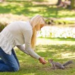 Beautiful woman with a squirrel - Foto Stock