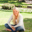 Woman sitting in the park — Stock Photo #10857442