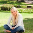 Woman sitting in the park — Stock Photo