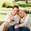 Stock Photo: Young couple taking a photo of themselves