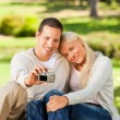 Royalty-Free Stock Photo: Young couple taking a photo of themselves