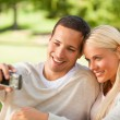 Young couple taking a photo of themselves — Stock Photo