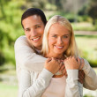Stock Photo: Woman hugging her boyfriend in the park