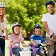 Stock Photo: Family in the park with their bikes