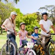 Royalty-Free Stock Photo: Family in the park with their bikes