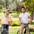 Stock Photo: Couple with their bikes in the park