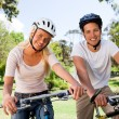 Couple in the park with their bikes — Stock Photo