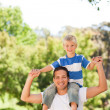 Mgiving son piggyback — Stock Photo #10857670