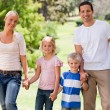 Adorable family in the park - Stock Photo