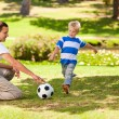Father playing football with his son — Stock Photo #10857830