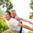 Father playing with his daughter in the park — Stock Photo