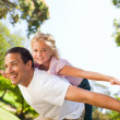 Father playing with his daughter in the park — Stock Photo #10857894