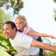 Father playing with his daughter in the park — Stock Photo #10857896