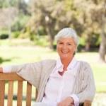Senior woman on a bench — Stock Photo #10857918