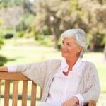 Senior woman on a bench — Stock Photo #10857919