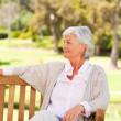 Senior woman on a bench — Stock Photo #10857924