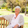 Senior woman on a bench — Stock Photo