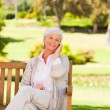 Elderly woman in the park — Stock Photo