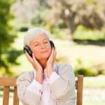 Senior woman listening to some music — Stock Photo #10858015