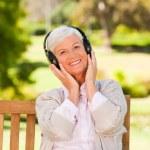 Senior woman listening to some music — Stock Photo #10858021