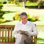 Man reading a newspaper — Stock Photo #10858160