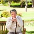 Elderly man with his walking stick - Stock Photo