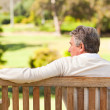 Senior man on the bench — Stock Photo