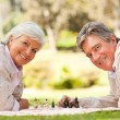 Retired couple playing chess — Stock Photo