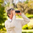 Mature man birds watching — Stock Photo