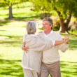 Mature couple dancing in the park — Stock Photo #10858414