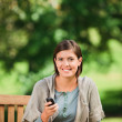 Woman phoning on the bench — Stock Photo #10858559