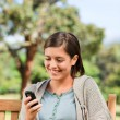 Young woman phoning on the bench — Stock Photo #10858664