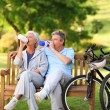 Elderly couple with their bikes — Stock Photo #10858709
