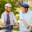 Mature couple with their bikes - Stock Photo