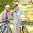 Mature couple with their bikes — Stock Photo #10858744
