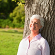 Senior woman in the park — Stock Photo