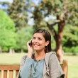 Young woman phoning on the bench — Stock Photo #10858817