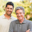 Stock Photo: Father with his son looking at camera