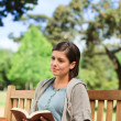 Lovely woman reading - Stock Photo