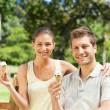 Couple eating an ice cream in the park — Stock Photo